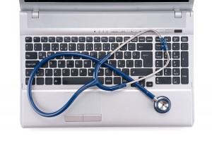 bigstock-Stethoscope-resting-on-a-compu-31701782