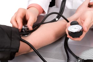 bigstock-doctor-checking-blood-pressure-17566802
